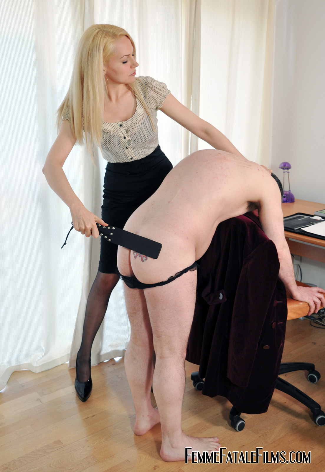 Spanked by a blonde milf