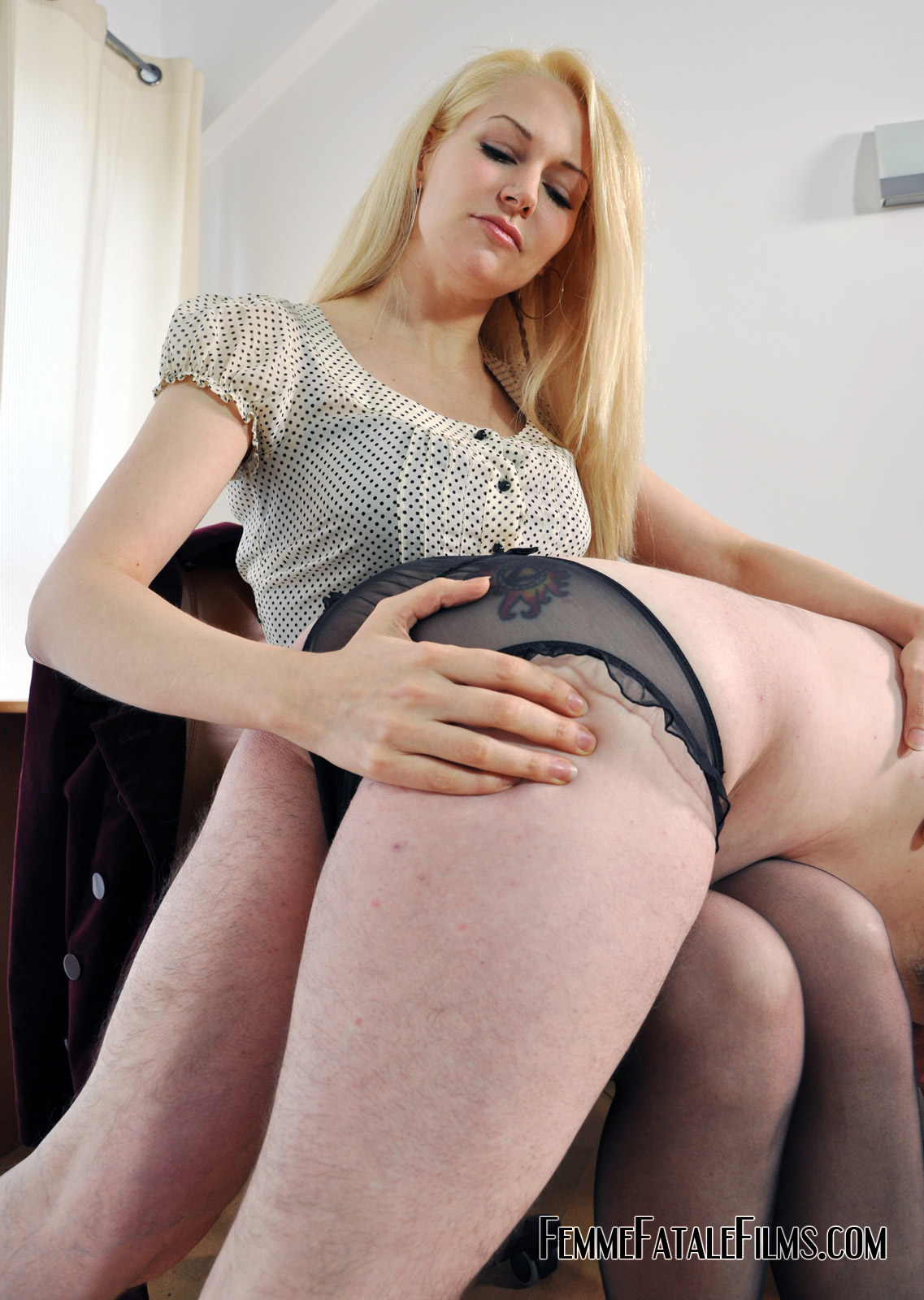 Blonde milf in stockings gets a spanking