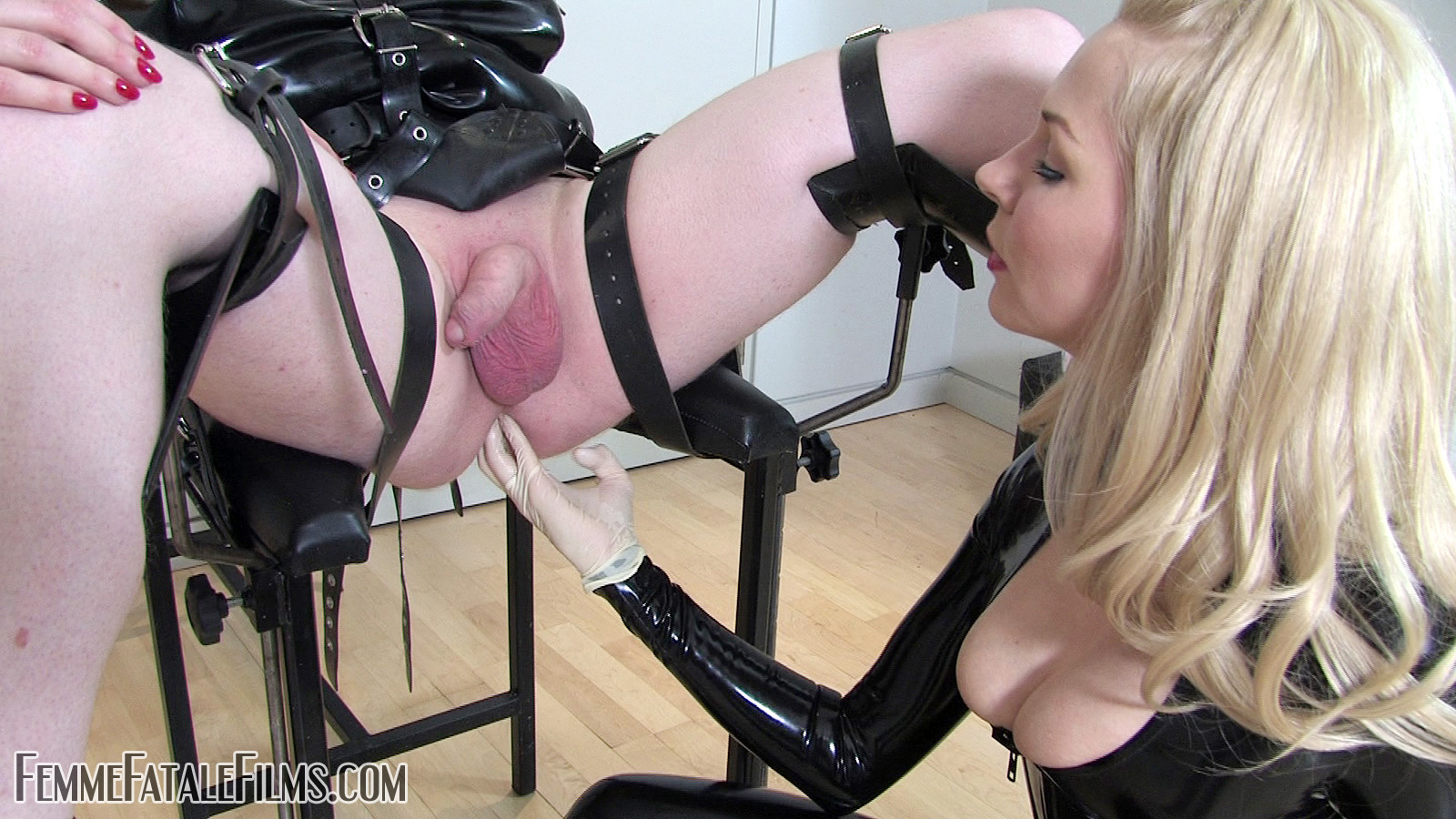 image 2 dommes fisting and footing a slave