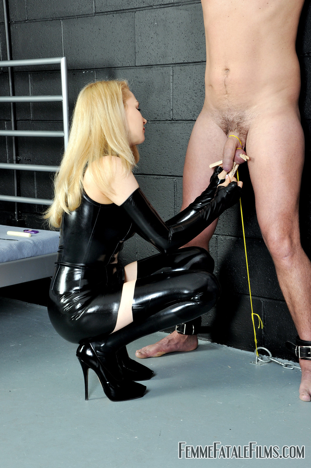 Blonde milf in boots gives cock and ball torture