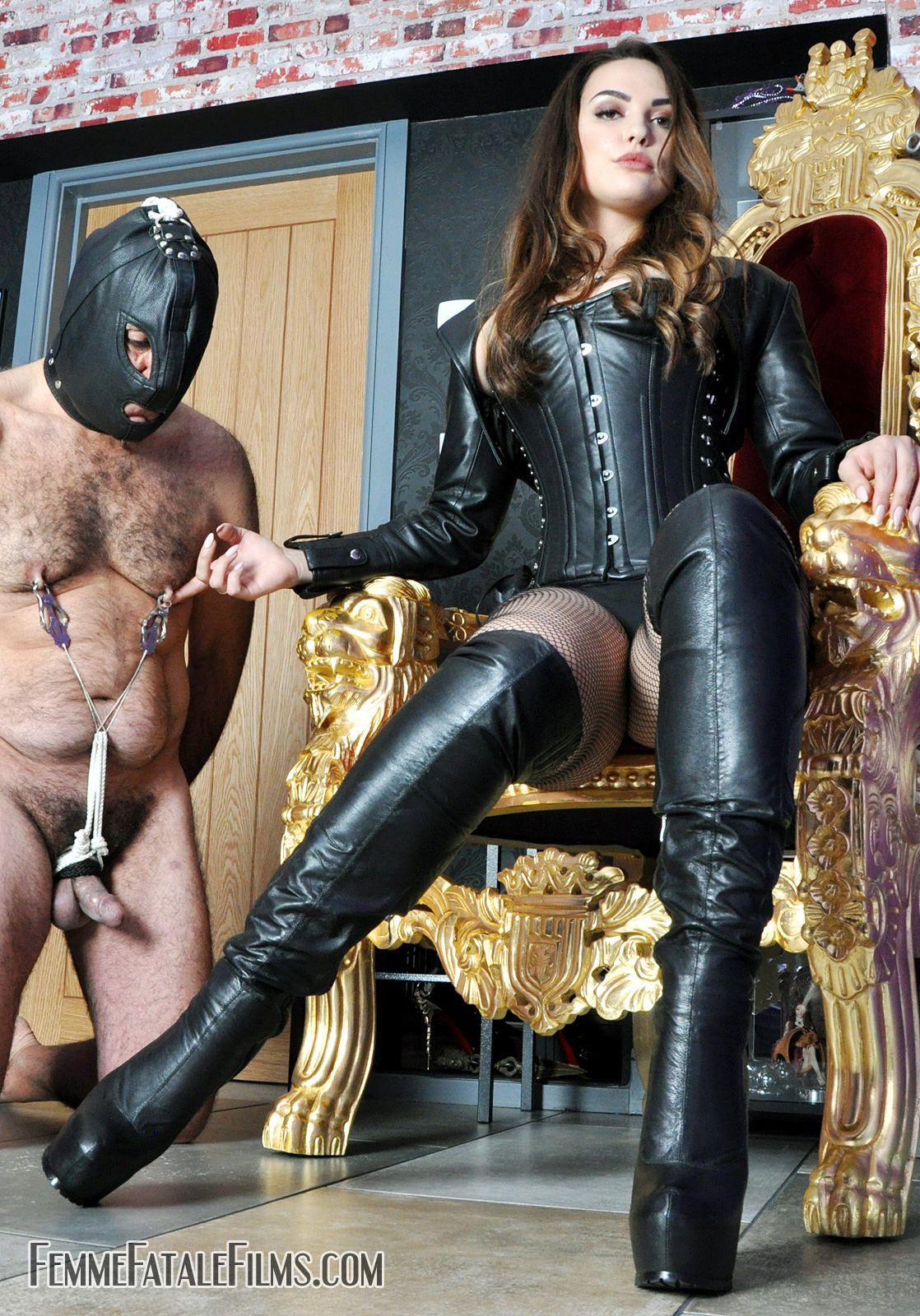 Nipple and cock and ball torture mistress in boots